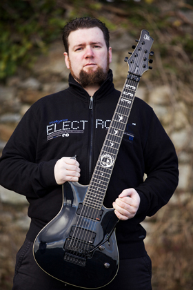 Fiachra holding his Mayones 7-string Setius Pro