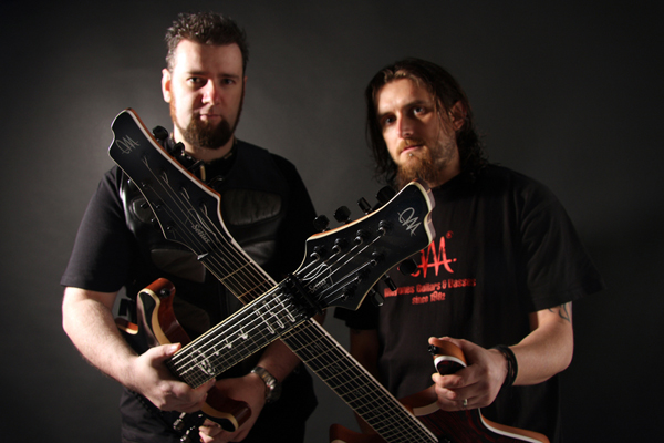 Fiachra and Gareth with their custom Mayones guitars